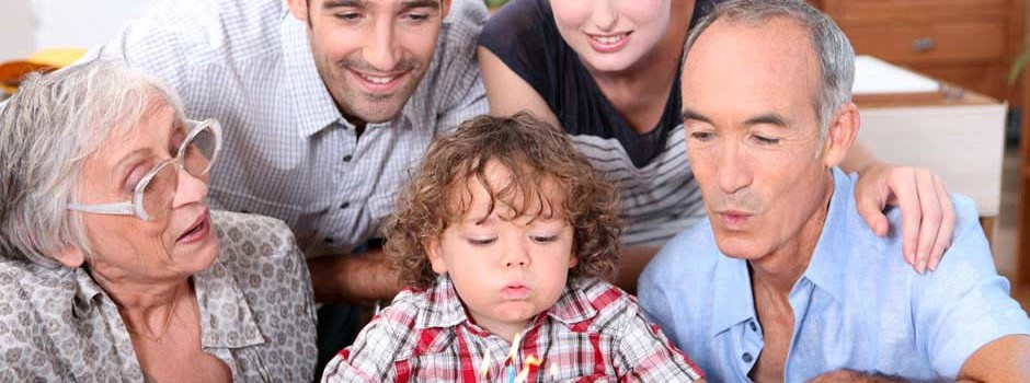 Intergenerational family at birthday party for young boy