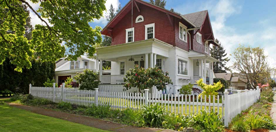 Country house with white picket fence