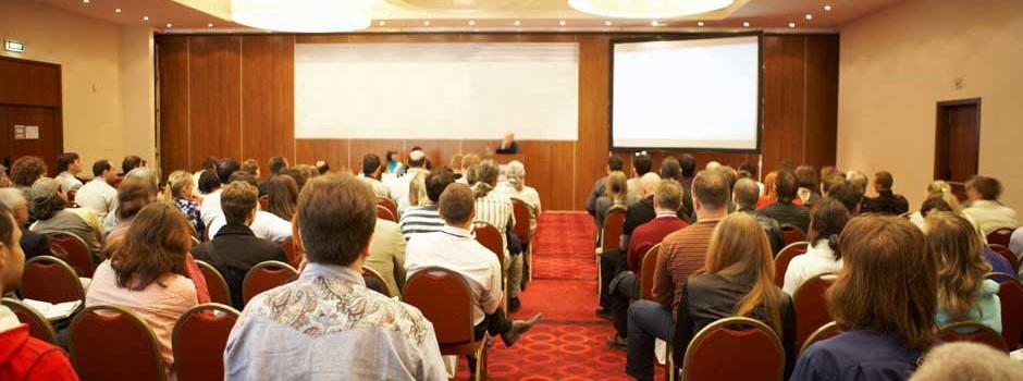 People at seminar sitting auditorium style